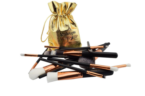 makeup brushes and a golden bag