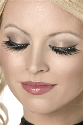 woman looking down wearing stunning long fake eyelashes