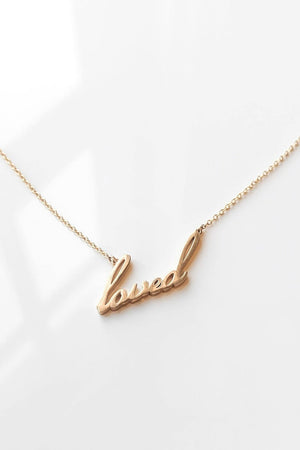 Thatch Jewelry Loved Script Necklace in Gold sold at Sway and Cake
