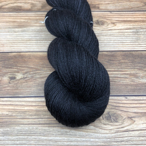 Camelot in Black Knight - Round Table Yarns hand-dyed yarn tonal semi-solid self-striping