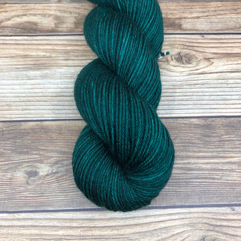 Cornwall in Green Knight - Round Table Yarns hand-dyed yarn tonal semi-solid self-striping