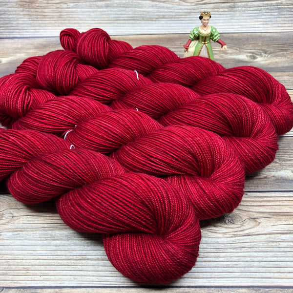 Tristan in Poisoned Apple - Round Table Yarns hand-dyed yarn tonal semi-solid self-striping