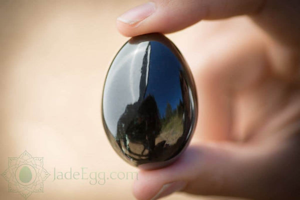 jade egg in clean hand