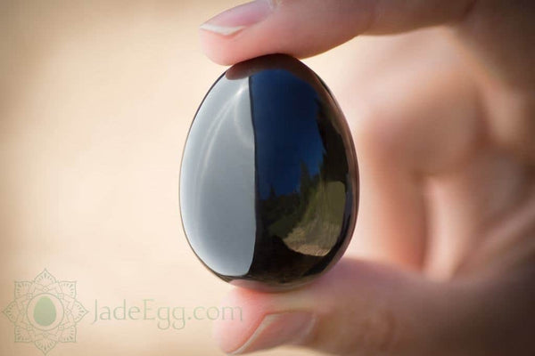 Jade egg in hand