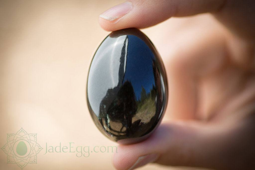 Nephrite jade egg held in hand