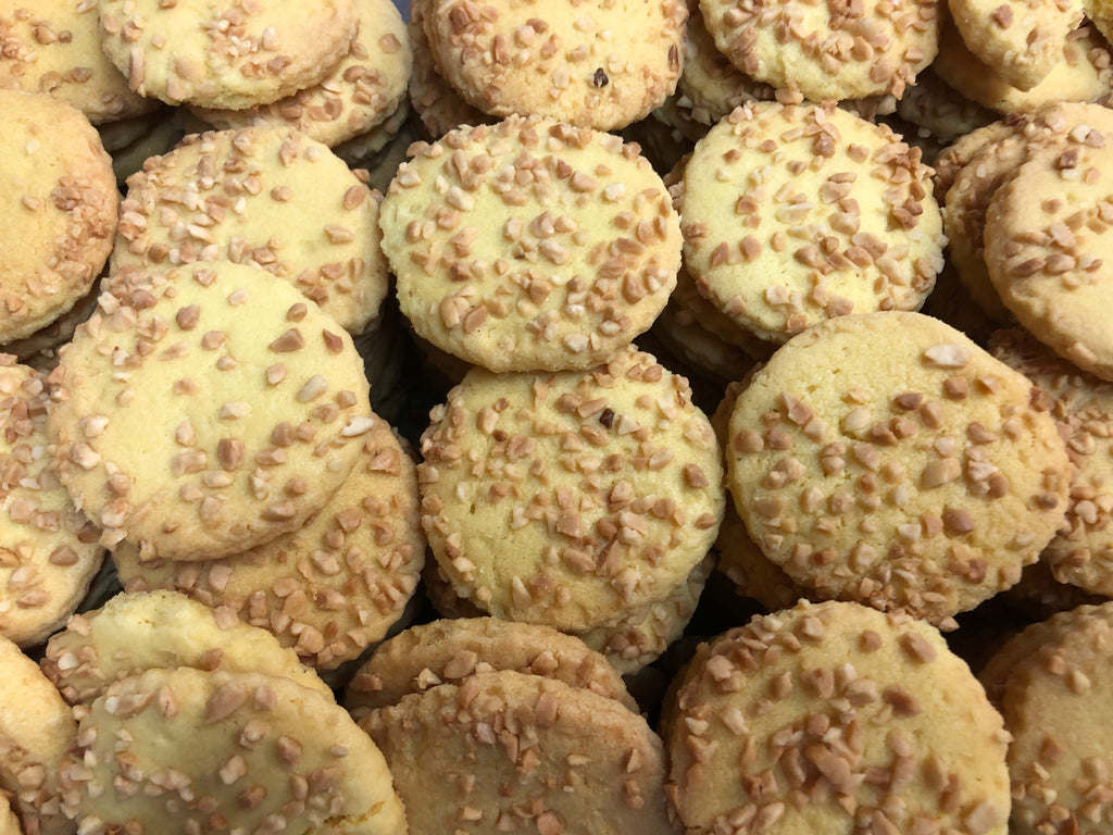 Peanut coated biscuits