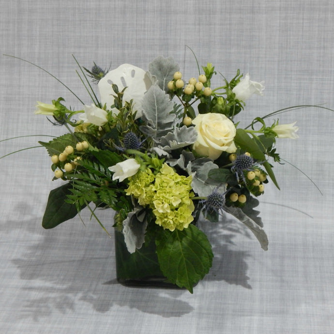 Cape Cod Inspired Flower arrangement with white roses, thistle, dusty miller & sand dollar