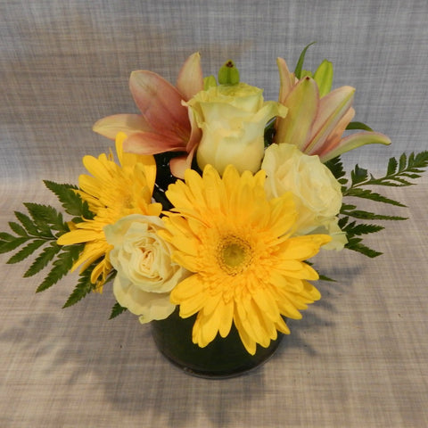 Yellow Gerbera Daisies, Soft Pink Lilies & White Roses in a Vase