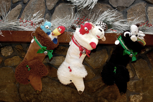 These Poodle shaped dog Christmas stockings are the perfect gift for stuffing toys and treats into to spoil your fur baby for Christmas, or whatever holiday you celebrate!