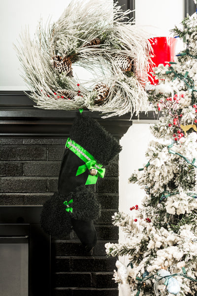 This Black Poodle shaped dog Christmas stocking is the perfect gift for stuffing toys and treats into to spoil your fur baby for Christmas, or whatever holiday you celebrate!
