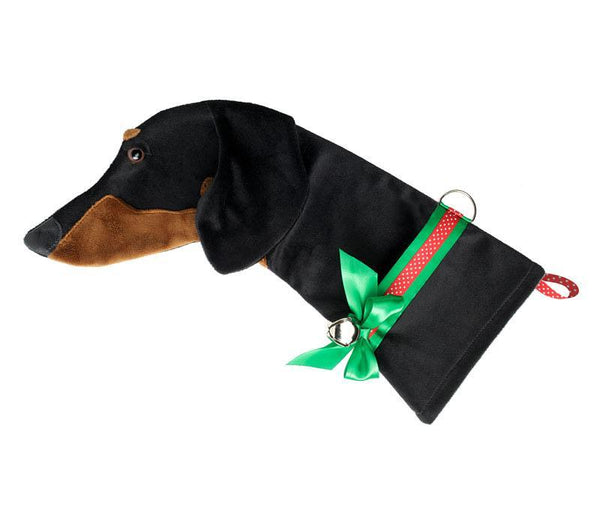 This Black and Tan Dachshund dog Christmas stocking is perfect for stuffing toys and treats into to spoil your fur baby for Christmas, or whatever holiday you celebrate!