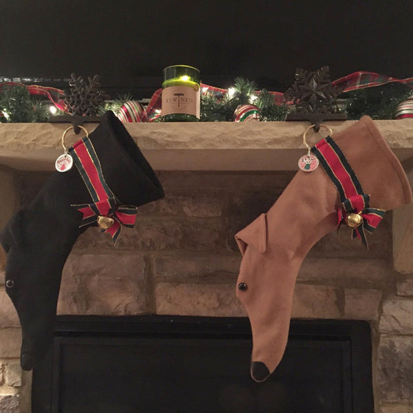 These Greyhound shaped Christmas dog stockings are a perfect for stuffing toys and treats into to spoil your fur baby for Christmas, or whatever holiday you celebrate!