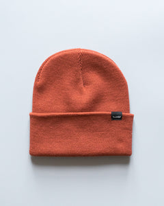 humbl streetwear beanie in burnt orange or dark red rust with logo tag