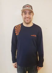 Jake Ott wearing navy long sleeved poly tee with orange GrypVyn™