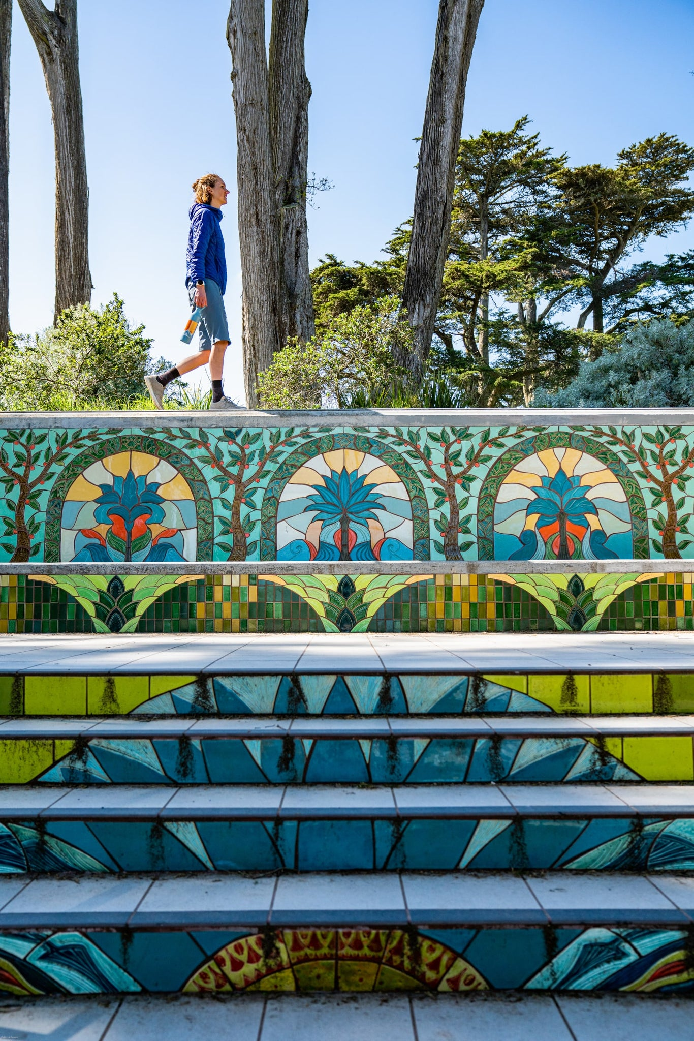 Person walking on mosaic stairs in San Francisco