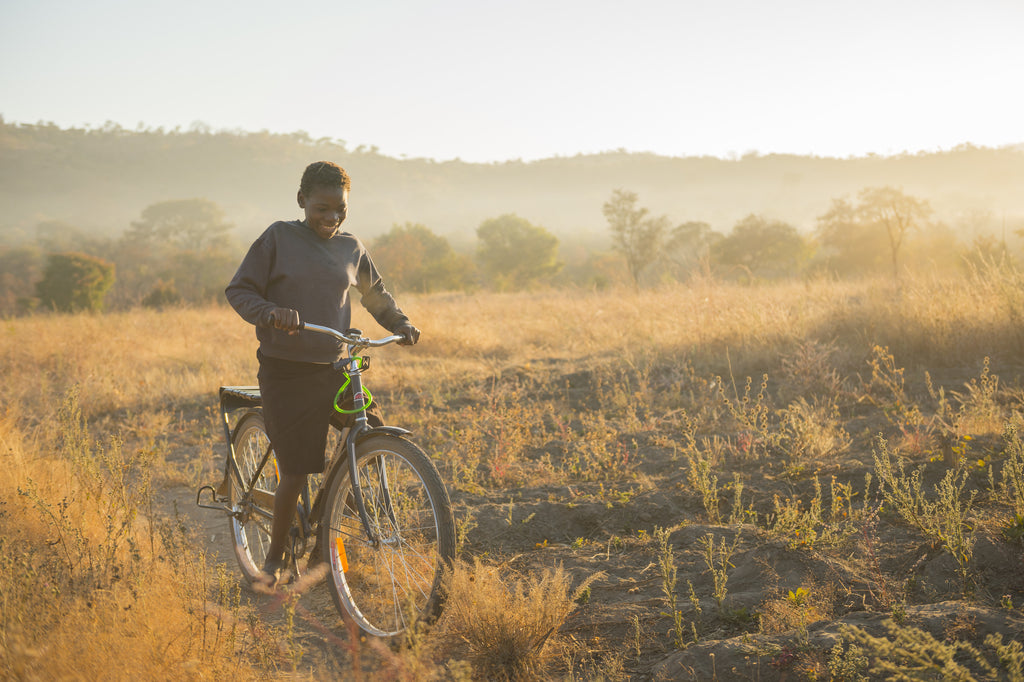 Kids riding bikes in Zambia