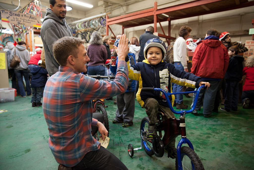 MiiR Employee Josh Stinger gives a high five at the Boise Bicycle Project