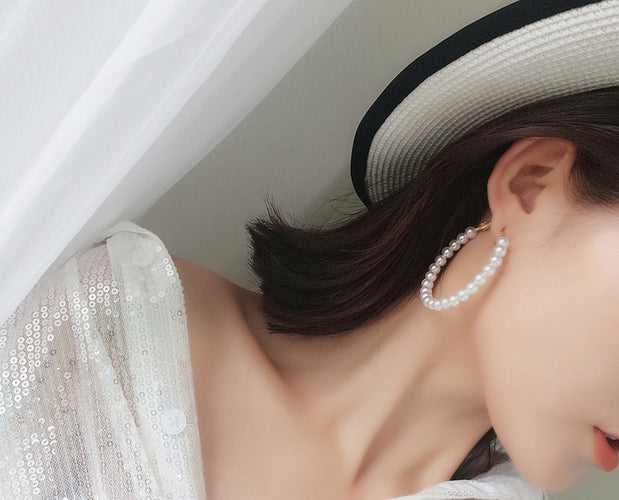 Extravagant Pearl Loop Styled Earrings