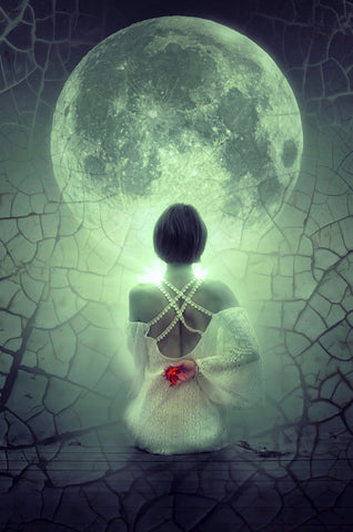 Woman manifesting with the moon