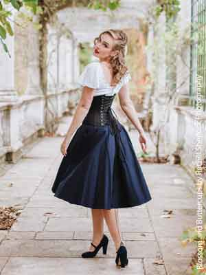 woman in a black satin Corset CS-411 wearing a cute summer dress
