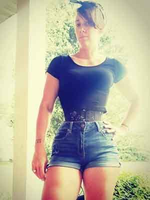 woman wearing Hourglass Curve longline underbust corset CS-426 in flower brocade fabric with denim shorts and black T-shirt