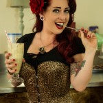woman drinking smoothie in corset