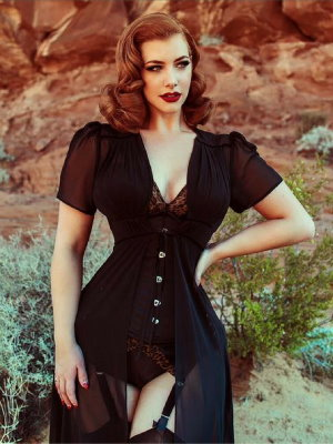 pinup style glam shot of woman in black corset style number CS-345 in satin