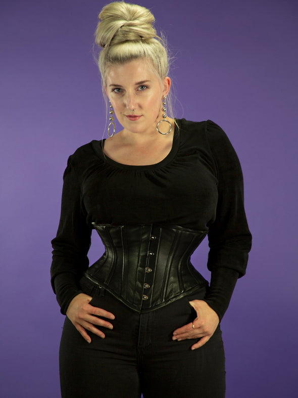 Model wearing the plus size 201 leather steel boned corset front view