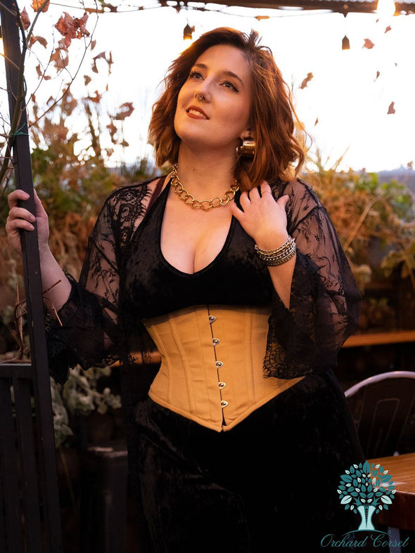 Model wearing cs201 waspie hourglass curve corset over black velvet jumpsuit and lace duster