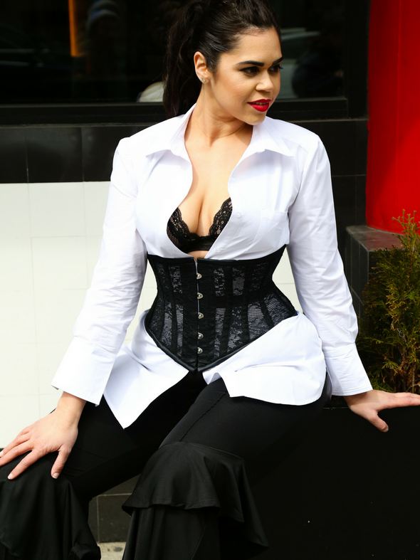 Model wearing our cs 201 black lace weave underbust waist training corset with a white button up shirt and black pants