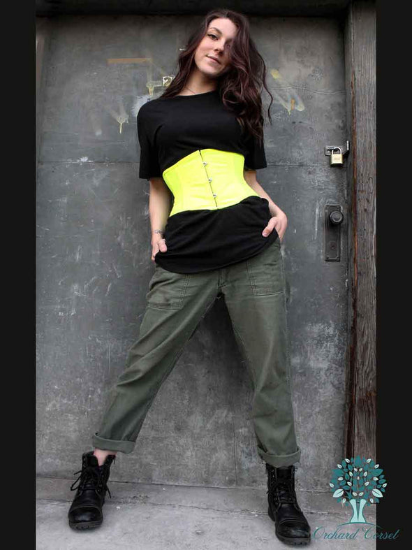 cs301 modern curve silhouette in NEON yellow green cotton corset on model in urban setting