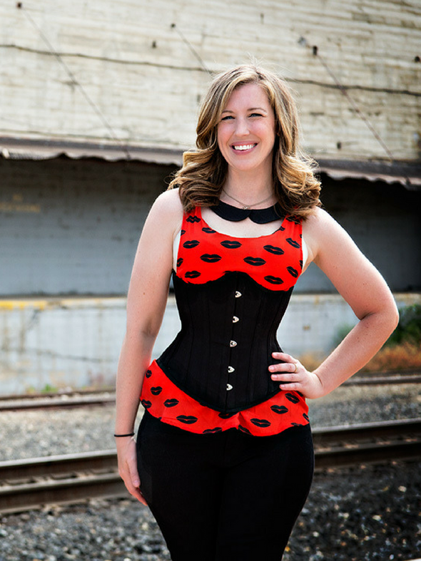 model wearing the plus size 345 black cotton steel boned corset