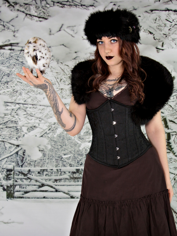 Model wearing a formal winter outfit with our underbust 345 black brocade steel boned waist training corset