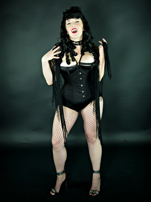 Model dressed as a vampire wearing our 411 longline corset in black cotton