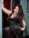 Model wearing black satin cs411 steel boned corset