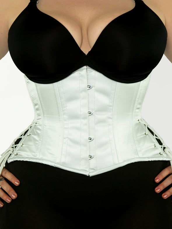Model wearing our plus size 426 with hip ties steel boned waist training corset in white satin