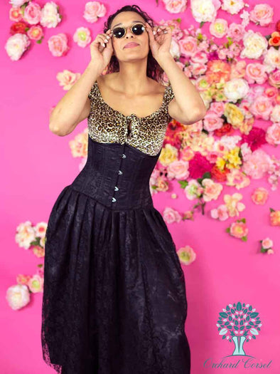 model wearing black lace 426 corset dress over leopard print top