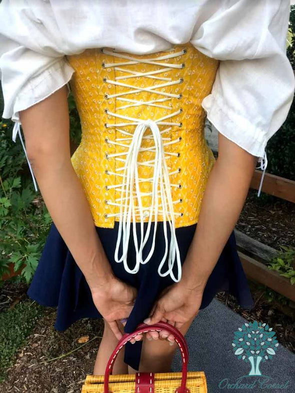 Back lace up view showing white lacing on a OC hourglass curve 426 longline corset in a lovely cotton saffron eyelet fabric