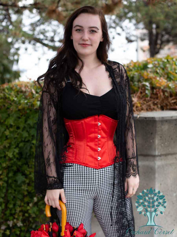 model with umbrella wearing 426 standard with hip ties in red satin valentines corset