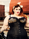 model wearing plus size black lamb leather 426 longline steel boned corset