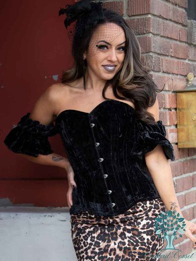 model wearing cs511 black velvet corset top with flutter sleeves with leopard print skirt and heels