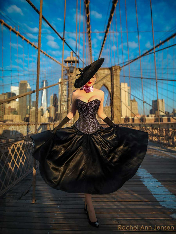 Romantic curve cs530 waist trainer corset top modeled by Rachel Ann Jensen on a bridge