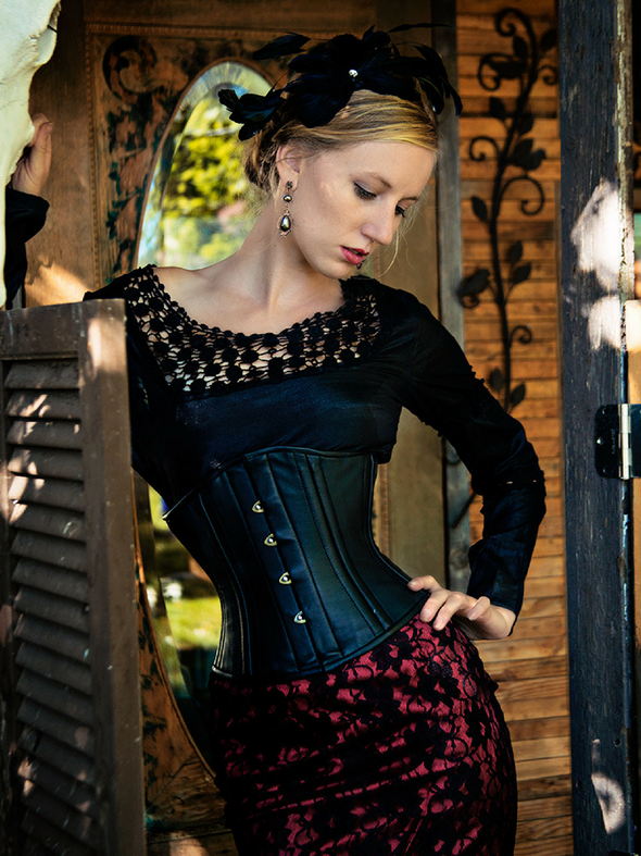 model wearing cs411 standard black leather steel boned corset front view