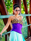 Model in a leopard print top wearing our purple satin 411