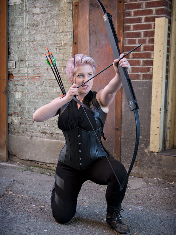 Archery model wearing our underbust 426 longline steel boned black leather corset lingerie
