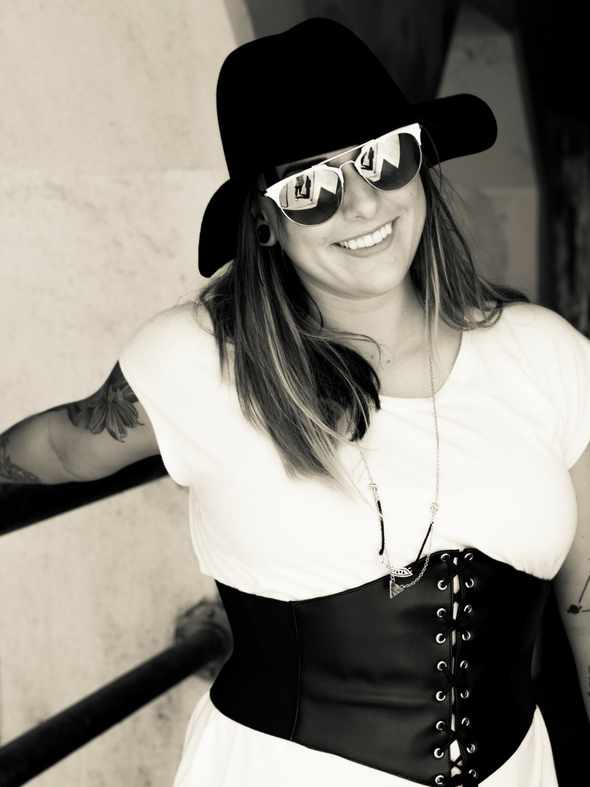 black and white shot of a model wearing our 920s Wide Faux leather lacing corset belt with snaps with the snaps open