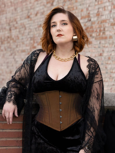 Black Friday special sale! red haired woman wearing the cs 201 waist trainer waspie in bronze shantung over a black velvet jumpsuit