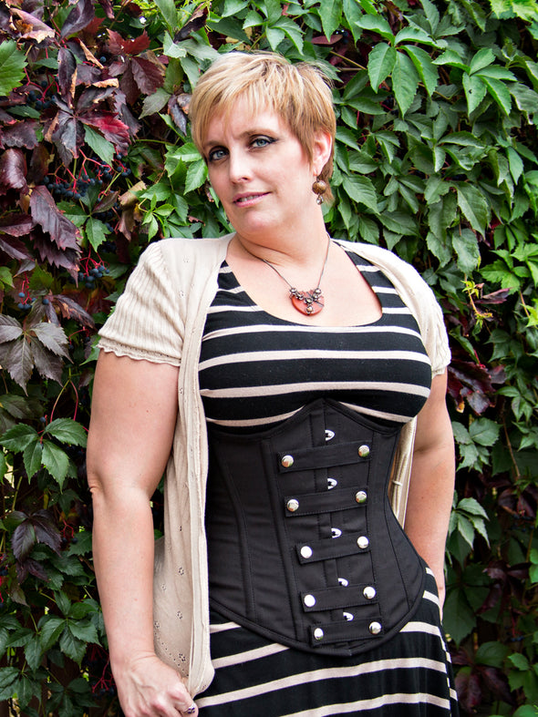 model wearing the plus size 345 black cotton with snaps steel boned corset