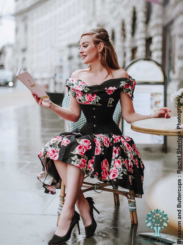 blossom and buttercups sitting at a cafe in a black floral dress under the cs 411 longline romantic curve corset