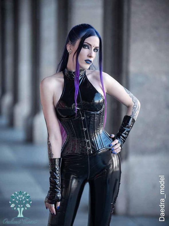 daedra_model wearing the black pvc cs426 hourglass curve corset with a black latex bodysuit and fingerless gloves
